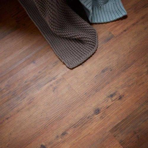 Distressed wood effect rigid vinyl flooring from the Revolution collection